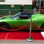 GREEN WITH ENVY: Tesla's EV at the Hertz party. (Photo: Jim Motavalli)